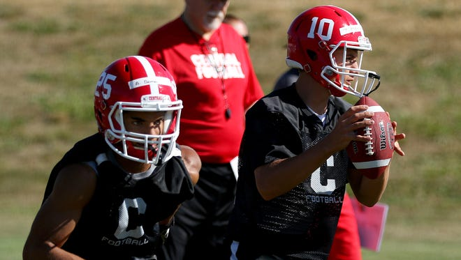 Central Panthers quarterback Peter Mendazona drops back to pass during practice, Monday, August 17, 2015, in Independence, Ore.