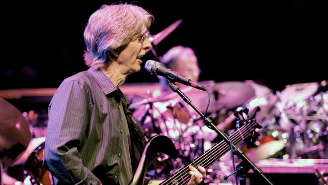 This May 9, 2009, file photo bassist Phil Lesh performs with The Dead, at the Forum in the Inglewood section of Los Angeles, Calif. Lesh says he has been diagnosed with bladder cancer and is being treated in Arizona.