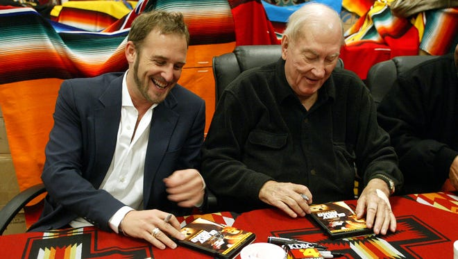 Glory Road star Josh Lucas shared a few laughs with former UTEP basketball coach Don Haskins as they signed DVDs for fans Saturday morning at the El Paso Saddleblanket.