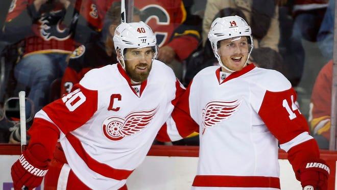 Red Wings captain Henrik Zetterberg, left, celebrates with Gustav Nyquist in Calgary.