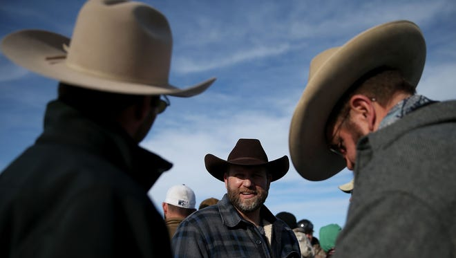 Ammon Bundy, the leader of an anti-government militia, talks with supporters in front of the Malheur National Wildlife Refuge Headquarters.