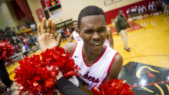 North Central junior Kris Wilkes (31) celebrates the first-round win in the Marion County tournament, Jan. 12, 2016.