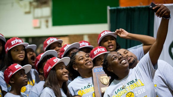 The Jeff Davis High School girls basketball assistant coach Jessica Holt takes a selfie of the team and staff as they celebrate winning their state championship during an assembly at the school in Montgomery, Ala. on Friday April 1, 2016.