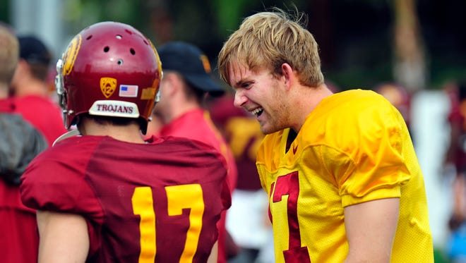 Jake Olson (right) is an inspiring figure on and off the USC football roster.