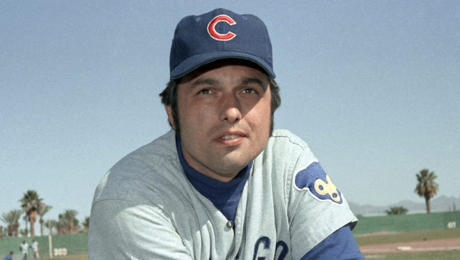 In this 1971, file photo, Chicago Cubs pitcher Milt Pappas poses during spring training baseball. Pappas, who won 209 games during his 17-year career with the Baltimore Orioles, Cincinnati Reds, Atlanta Braves and Chicago Cubs died Tuesday morning, April 19, 2016, of natural causes at his home in the northern Illinois community of Beecher, his widow, Judi Pappas said. He was 76.