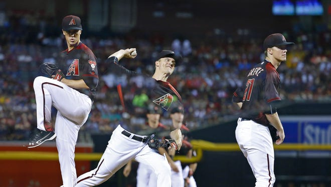 Arizona Diamondbacks starting pitcher Zack Greinke (21) throws in this triple exposure during the 4th inning against the Colorado Rockies in their MLB game Saturday. April 30, 2016 in Phoenix.