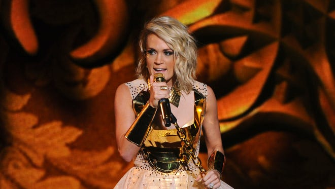Carrie Underwood performs during the American Country Countdown Awards at the Forum on Sunday in Inglewood, Calif.