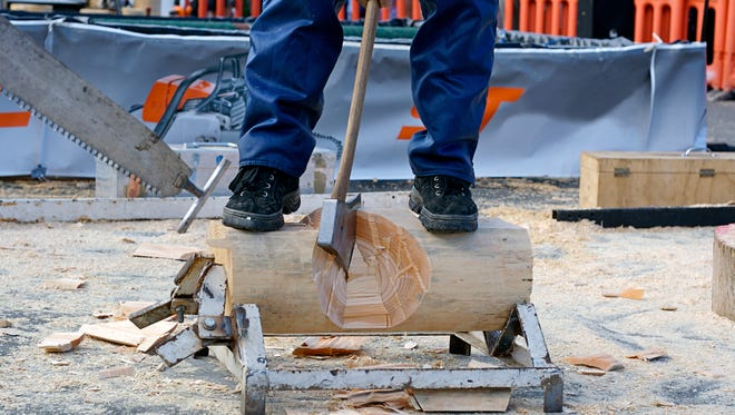 Axeman at a wood chopping competition