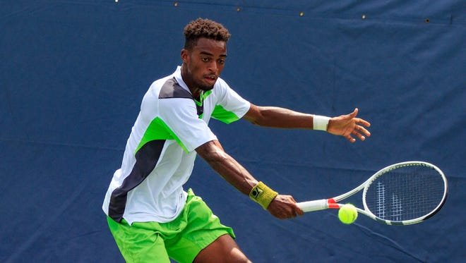 Darian King, of Barbados, returns serve on the way to a 6-2, 6-3 victory over American Mitchell Krueger in the singles final Sunday at the Levene Gouldin & Thompson Tennis Challenger at Recreation Park in Binghamton.