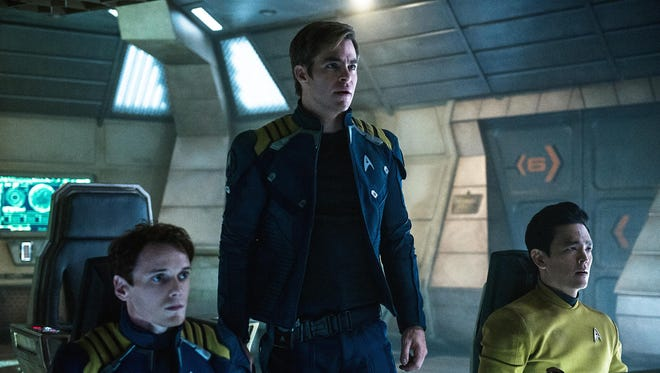 "Anton Yelchin (from left), Chris Pine and John Cho appear in a scene from ""Star Trek Beyond."""