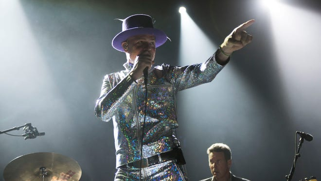 Gord Downie, center, and Gord Sinclair of The Tragically Hip perform  Aug. 10 in Toronto during the band's farewell tour.