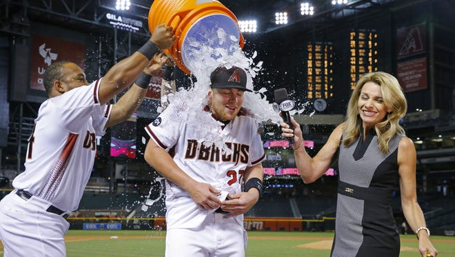 Arizona Diamondbacks' Brandon Drury (27) gets doused after his walk off sac fly in the 11th inning of their MLB game against the Atlanta Braves Wednesday, Aug. 24, 2016 in Phoenix,  Ariz.