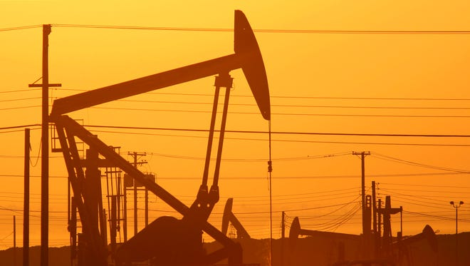 Pump jacks are seen at dawn in an oil field over the Monterey Shale formation where gas and oil extraction using hydraulic fracturing, or fracking, is booming near Lost Hills, Calif.