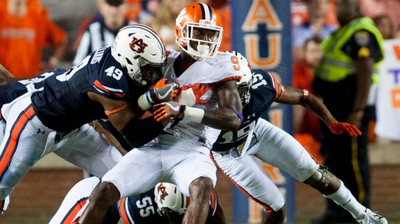 Clemson running back Wayne Gallman (9) is stopped by Auburn linebacker Darrell Williams (49) and defensive back Joshua Holsey (15) at Jordan-Hare Stadium in Auburn, Ala., on Saturday September 3, 2016.