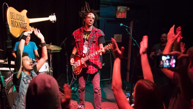 Hard rock band Radkey from St. Joseph, Mo. plays at the Black Cat in Washington, D.C. on Sept. 1. Isaiah, bass;  Solomon, drums; and Dee Radke, guitar/vocals.