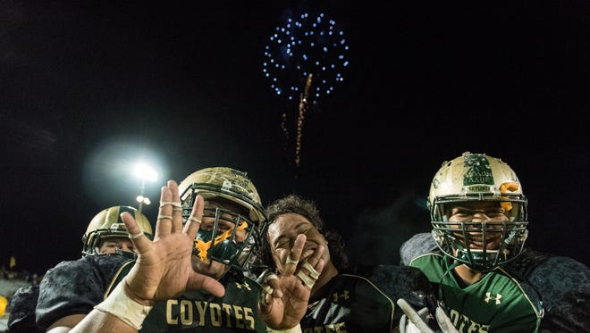Skyline players celebrate their victory against Red Mountain and their 8-1 record clinching them their section championship on Friday, Oct. 21, 2016, at Skyline High School in Mesa, Ariz.