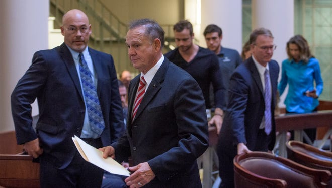 Roy Moore and his attorney and supporters walk out of the Supreme Court Chamber, in Montgomery, Ala., on Thursday October 27, 2016 before the lottery is held to pick the judges who will hear his appeal.