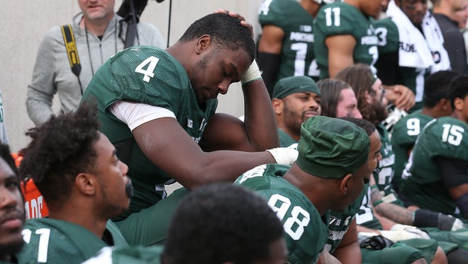 Malik McDowell (4) of the Michigan State Spartans sits on the bench against Michigan on Oct. 29, 2016, in East Lansing.