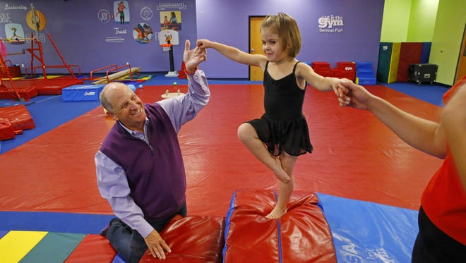 Ruk Adams, the CEO of The Little Gym International, helps Isabella Najarian, 3, balance on Nov. 21,  2016, at The Little Gym of Paradise Valley.