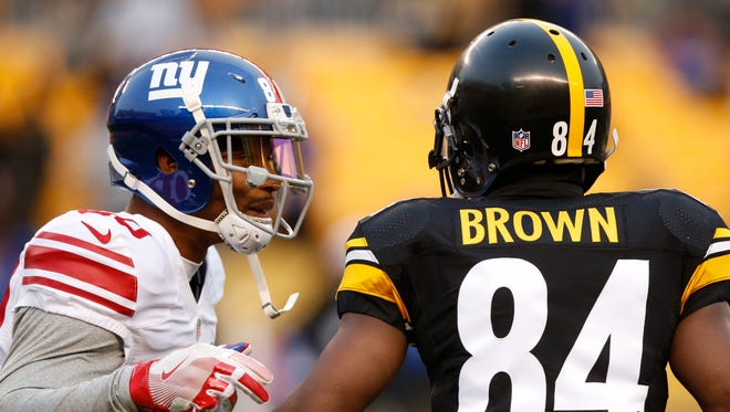 New York Giants wide receiver Victor Cruz, left, and Pittsburgh Steelers wide receiver Antonio Brown (84) visited during warmups before Sunday's game.