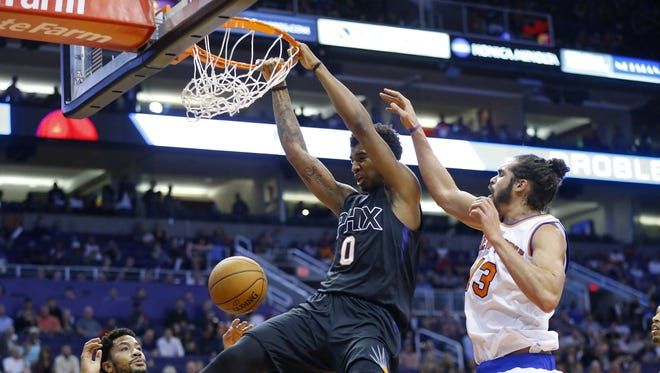 Suns forward Marquese Chriss (0) gets a slam dunk against the Knicks in the first half of their NBA game, Tuesday, Dec. 13, 2016 in Phoenix, Ariz.