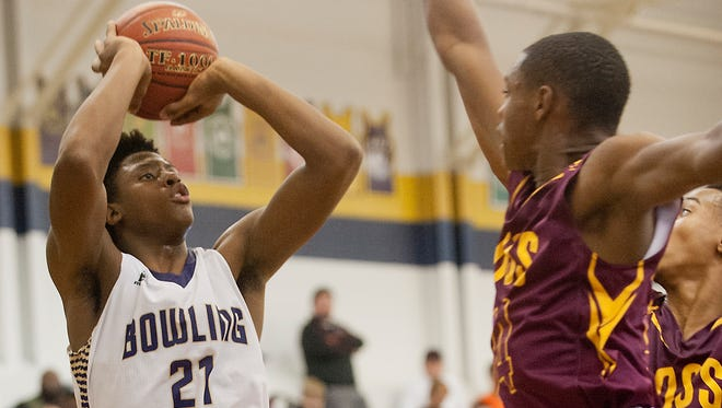 Bowling Green forward Terry Taylor prepares to shoot over Doss forward Terez Traynor. Taylor  scored 18 points in the game, the second highest scorer of the night, helping the #1 ranked Bowling Green Purples defeat the defending state champion Doss Dragons, 60-50.17 December 2016