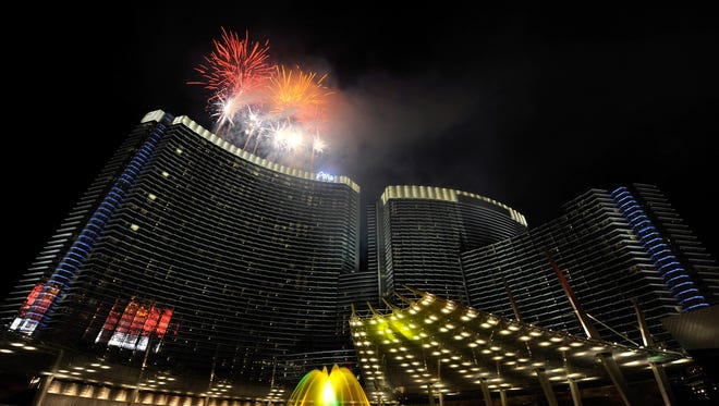 Fireworks explode over the Aria Resort & Casino at CityCenter as part of a New Year's Eve celebration January 1, 2010 in Las Vegas, Nevada.