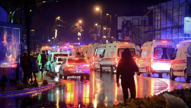 Medics and security officials work at the scene Jan. 1, 2017, after an attack at a popular nightclub in Istanbul.