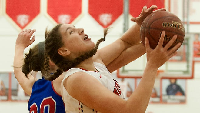 Mercer County forward Emmy Souder pressures Butler center Molly Lockhart as she drives to the basket.07 January 2017