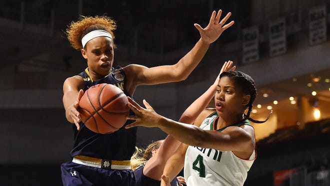 Notre Dame Fighting Irish forward Brianna Turner (11) steals the pass from Miami Hurricanes guard Shaneese Bailey (4) during the second half at Watsco Center. The Notre Dame Fighting Irish defeat Miami Hurricanes 67-55.