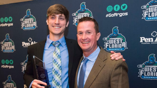 UWF baskeball Mike Jeffcoat, right, shown with former star player Greg Pron during the  UWF Athletics Hall of Fame banquet last month when Pron was inducted, reached his own major feat Sunday when earning a 400th career win in the Argos comeback victory at Valdosta State. .