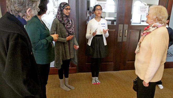 Isra Ahmed and Sariya Banday lead a group of visitors on a tour of Masjid Al-Noor, the only mosque in Waukesha County, during an open house on Jan. 21. Members of the mosque have been on-edge of late with President Donald Trump having implemented a ban on refugees and immigrants from seven Muslim majority nations.