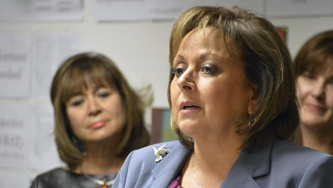 New Mexico Gov. Susana Martinez talks to reporters at the Mission Achievement and Success Charter School in Albuquerque on Jan. 10.