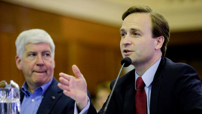 Gov. Rick Snyder listens as Lt. Gov. Brian Calley talks about the fiscal year 2018 and 2019 budget recommendation on Wednesday, Feb. 8, 2017 before a joint meeting of the state Senate and House appropriations committees at the Boji Tower in downtown Lansing.
