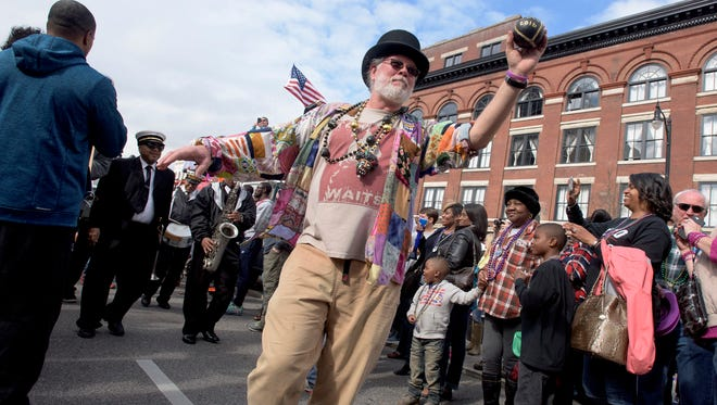 Willie Cox leads the Treme Brass Band up Commerce Street at the Mardi Gras Block Party & Cajun Cook-Off  in downtown Montgomery, Ala. on Saturday February 18, 2017.