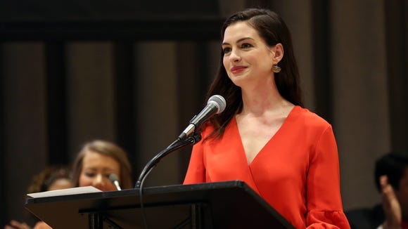 Anne Hathaway speaks during International Women's Day