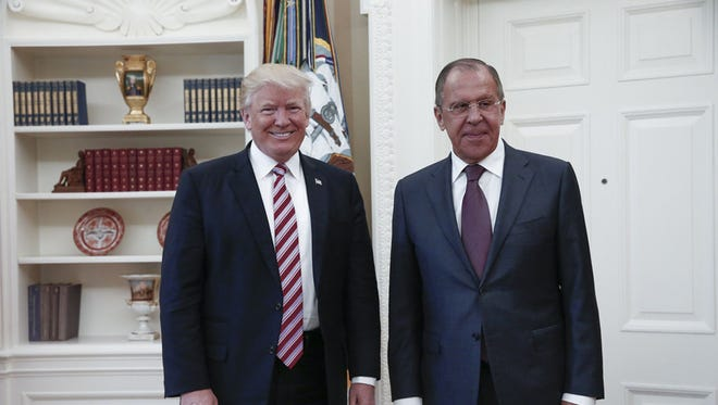 This file handout photo taken on May 10, 2017 made available by the Russian Foreign Ministry shows shows US President Donald J. Trump posing with Russian Foreign Minister Sergei Lavrov during their meeting at the White House. (Editor's note: USA TODAY does not generally use government handout photos but makes exceptions where there is extraordinary news value.)