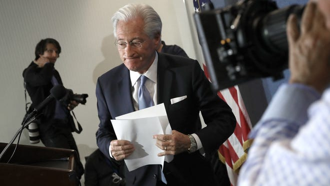Marc Kasowitz, attorney for U.S. President Donald Trump, departs after speaking at the National Press Club June 8.
