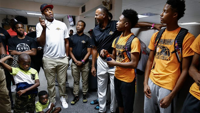"Team Penny guard Jayden Hardaway (far right) listens to father and former NBA All-Star Anfernee ""Penny"" Hardaway (middle) after defeating Nike Team Florida at the 2017 Nike Peach Jam in North Augusta, S.C."