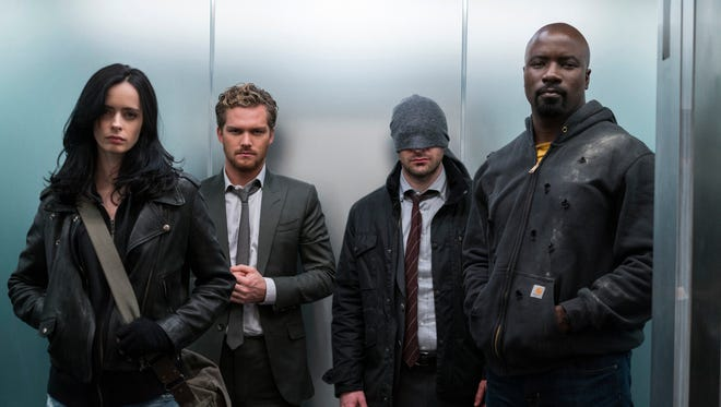 Jessica Jones (Krysten Ritter), Iron Fist (Finn Jones), Daredevil (Charlie Cox) and Luke Cage (Mike Colter) in 'Marvel's The Defenders.'