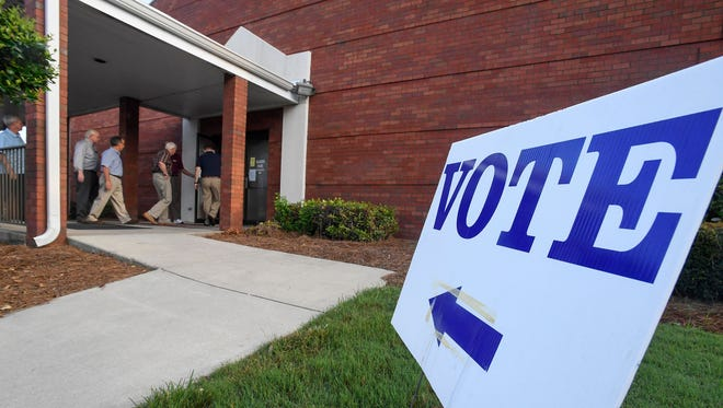 Voters arrive Aug. 15, 2017, at Vaughn Park Church of Christ in Montgomery, Ala., to vote in the primary election to for Attorney General Jeff Session's old Senate seat.