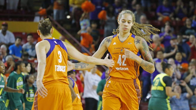 Phoenix Mercury guard Diana Taurasi (3) and center Brittney Griner (42) celebrate in the closing seconds of their win over the Seattle Storm in  their WNBA first-round playoff game Wednesday, Sept.  6,  2017, in Tempe, Ariz.