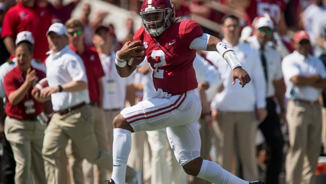 Alabama quarterback Jalen Hurts (2) carries for a touchdown in first half action at Bryant Denny Stadium in Tuscaloosa, Ala., on Saturday September 9, 2017. (Mickey Welsh / Montgomery Advertiser)