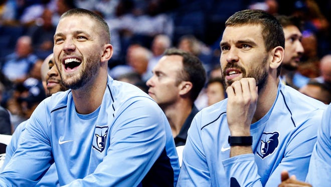 Memphis Grizzlies  teammates Chandler Parsons (left) and Marc Gasol (right) watch action against the Orlando Magic during first quarter action at the FedExForum in Memphis, Tenn., Monday, October 2, 2017.