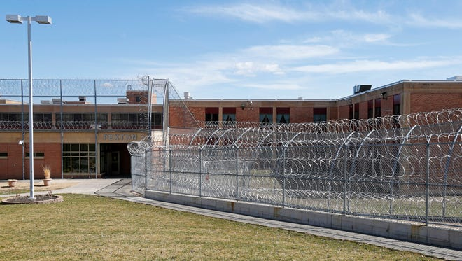 FILE - This March 28, 2017 file photo shows the Pexton Building, surrounded by barbed wire fencing, at the Minnesota Sex Offender Program in St. Peter, Minn. The U.S. Supreme Court ruled Monday, Oct. 2, 2017, that it won't hear a challenge to Minnesota's sex offender civil commitment system, which allows people who have been deemed sexually dangerous to be committed to a treatment facility for an indefinite period of time.