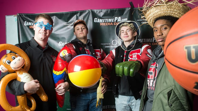 Susquehannock boys' basketball players Hunter Sentz, Jackson Murphy and Jordan McMillion with coach Andy Shelow, November 11, 2017. Teams from around the YAIAA had fun posing with props for GameTimePa's photo booth.