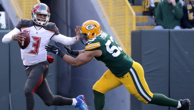 Tampa Bay Buccaneers quarterback Jameis Winston (3) scrambles away from pressure by Green Bay Packers outside linebacker Nick Perry (53) on December 3, 2017, at Lambeau Field in Green Bay, Wis.