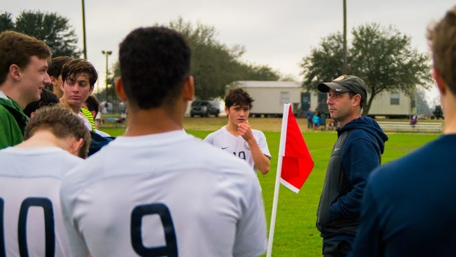 Episcopal School of Acadiana head soccer coach Jonathan Brunet talks to his players and listens to what they have to say as the Falcons take on Ascension Christian's Lions in a playoff game Tuesday Feb. 6, 2018.