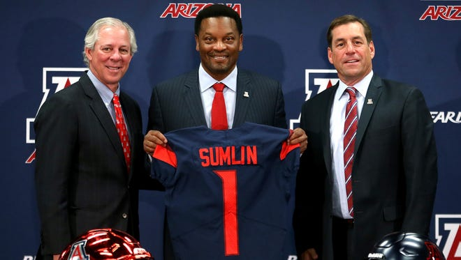 New University of Arizona Wildcats head football coach Kevin Sumlin, center, poses with UA president Robert Robbins, left, and athletic director Dave Heeke, right, during Sumlin's introductory press conference at the Lowell-Stevens Football Facility on Jan. 16, 2018, in Tucson, Ariz. Sumlin succeeds Rich Rodriguez, who was fired in December 2017.