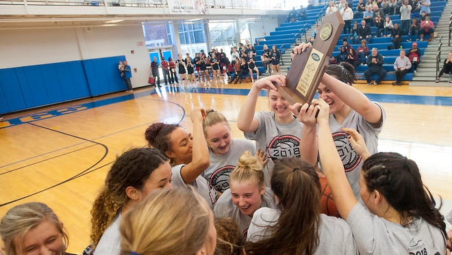 Mercy reacts to its win in the Sixth Region girls basketball championship. Saturday, March 3, 2018